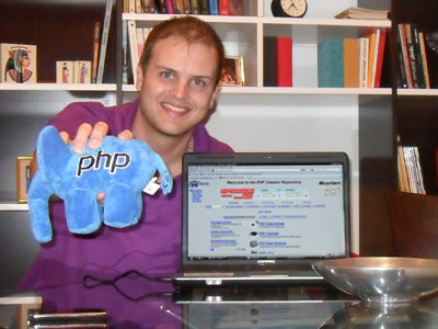 Picture of Guilherme Ribas holding the elePHPant PHP mascot toy